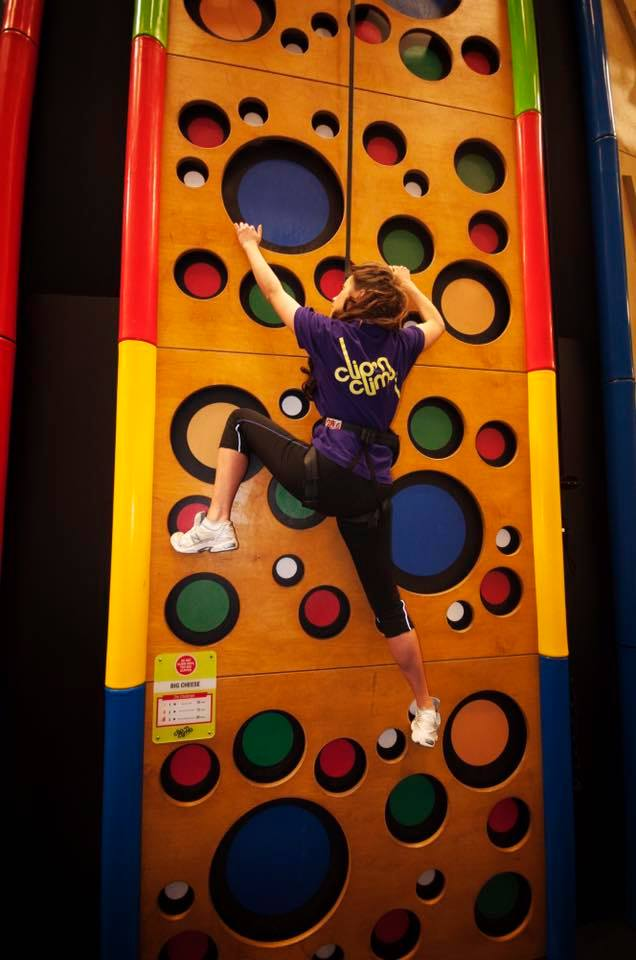 Girl on kids climbing wall